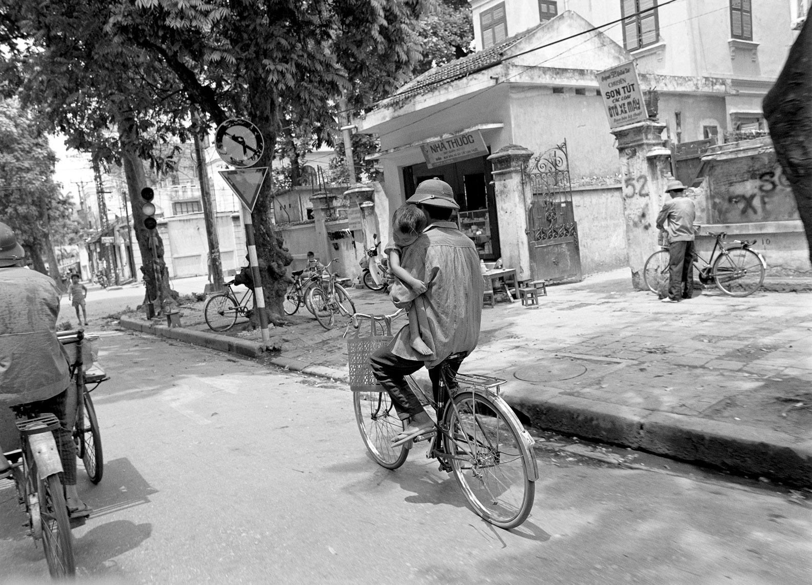 Vietnamese Father with Child on bike